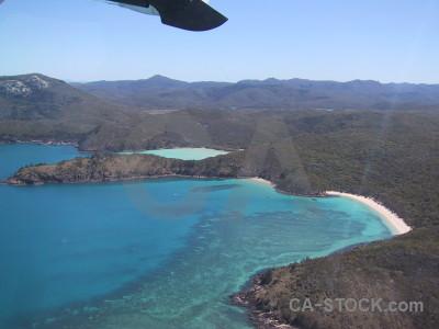 Aerial sea cyan blue island.