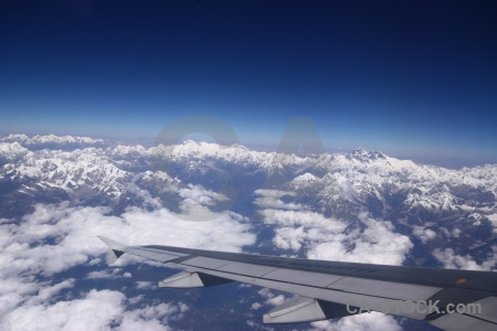 Airplane sky wing snowcap everest.