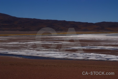 Altitude lake andes mountain salt flat.