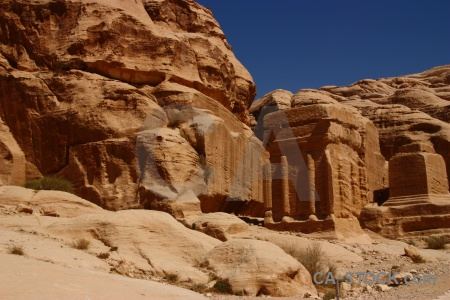 Ancient nabataeans carving cliff tomb.