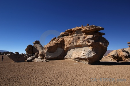 Andes rock formation mountain sky siloli desert.