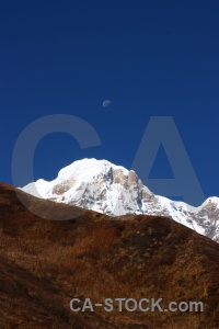 Annapurna south snowcap asia sky modi khola valley.