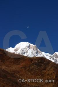 Annapurna south snowcap asia sky modi khola valley.