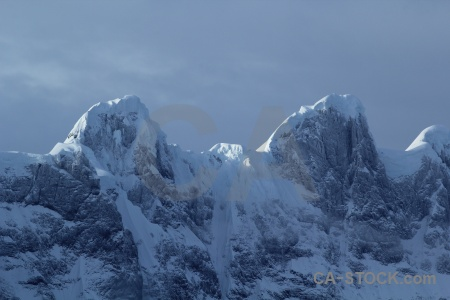 Antarctic peninsula landscape snowcap cloud antarctica.