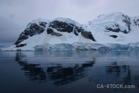 Antarctic peninsula south pole reflection snowcap mountain.