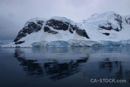 Antarctic peninsula south pole reflection snowcap mountain.