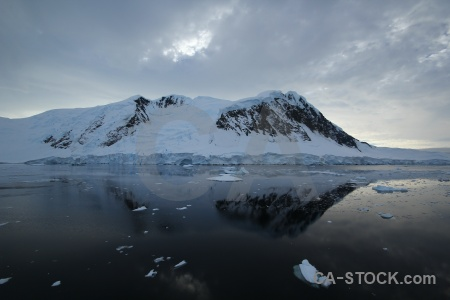 Antarctica channel reflection sea snowcap.