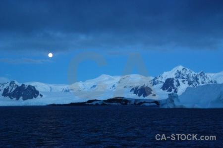 Antarctica cruise argentine islands snowcap moon ice.