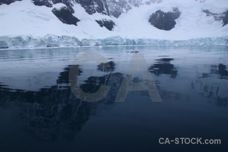 Antarctica cruise glacier ice snow reflection.