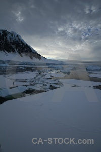 Antarctica cruise sea mountain cloud gunnel channel.