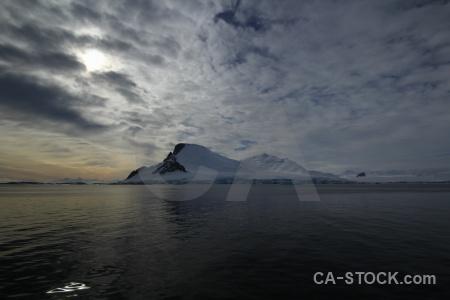 Antarctica cruise snow cloud sky landscape.