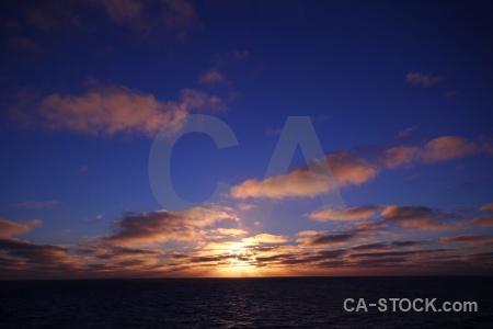 Antarctica cruise sun sky sunrise sea.