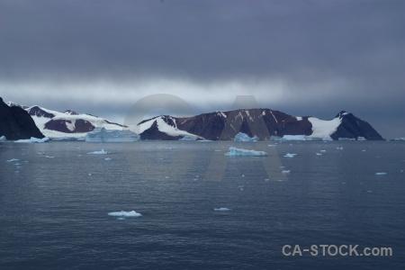 Antarctica mountain cloud ice water.