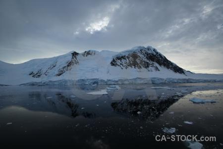 Antarctica mountain sea ice cloud snow.