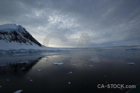 Antarctica sea ice sky adelaide island mountain.