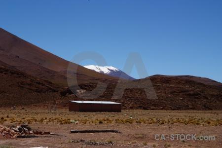 Argentina desert sky snowcap mountain.