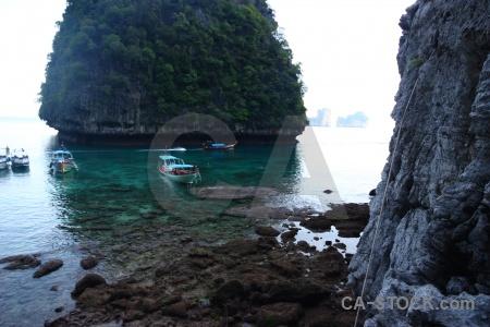 Asia boat island ko phi leh cliff.