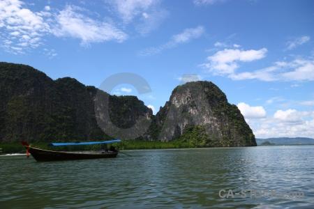 Asia boat limestone sky tropical.