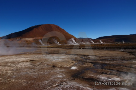 Atacama desert mountain el tatio steam landscape.