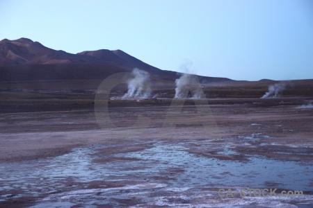 Atacama desert steam andes geyser sky.