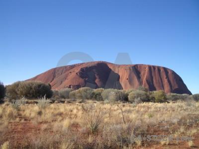 Ayers rock desert australia uluru cliff.