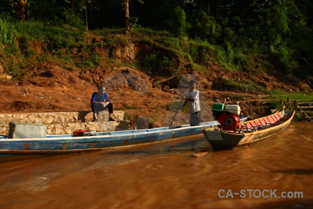 Ban en water person boat laos.