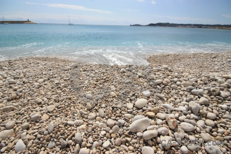 Beach javea sky stone spain.