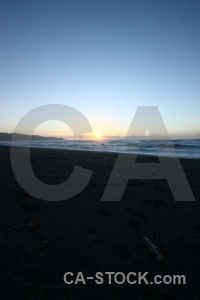 Beach sunrise sky west coast water.