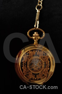 Black object pocket watch brown.