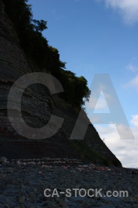 Black rock blue cliff.