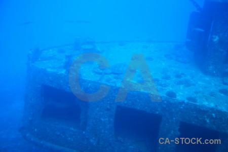 Blue cyan wreck underwater.