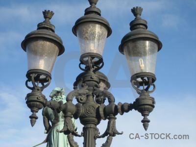 Blue ornate lamp post building.