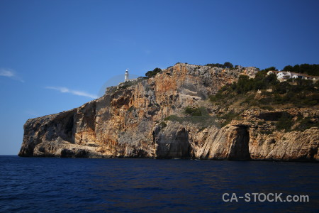 Blue rock spain javea lighthouse.