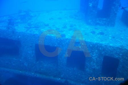 Blue wreck cyan underwater.