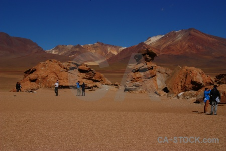 Bolivia mountain person sky sand.