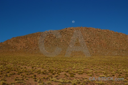 Bolivia rock sky grass landscape.