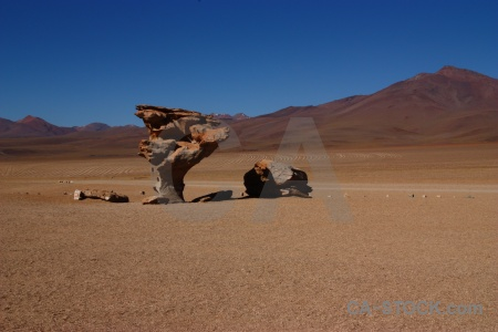 Bolivia siloli desert landscape rock sky.