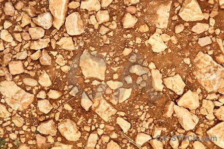 Brown gravel orange texture stone.