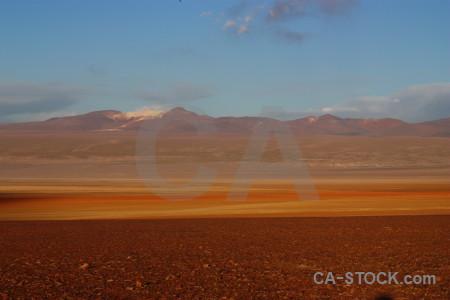 Brown landscape orange desert blue.