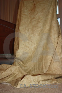 Brown object curtain cloth.