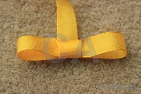Brown object ribbon yellow orange.
