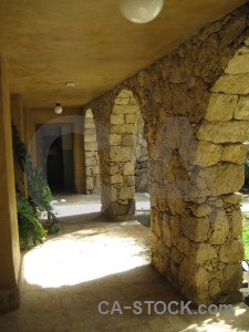 Brown stone archway.
