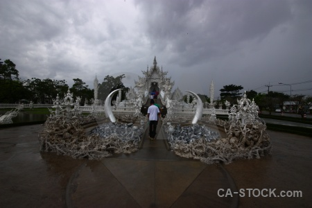Buddhist thailand ornate wat rong khun person.