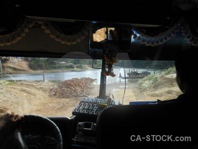 Bus inside southeast asia road water.