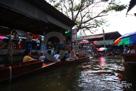 Canal floating person southeast asia damnoen saduak.