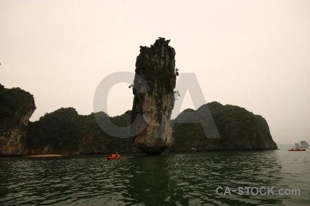 Canoe sea cliff southeast asia unesco.