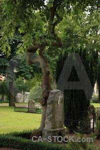 Cemetery statue grave green.