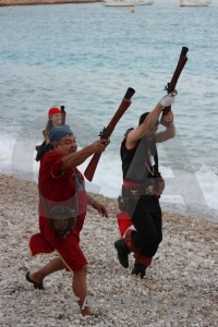 Christian beach person stone gun.