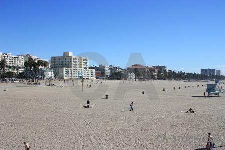 Cityscape blue beach building person.