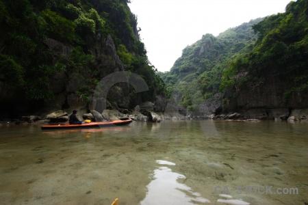 Cliff limestone person ha long bay rock.